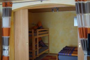 Etagenbett im Schlafzimmer | Ferienwohnung Ambiente am Europa-Park Rust