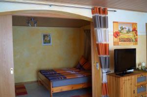 Doppelbett im Schlafzimmer | Ferienwohnung Ambiente am Europa-Park Rust